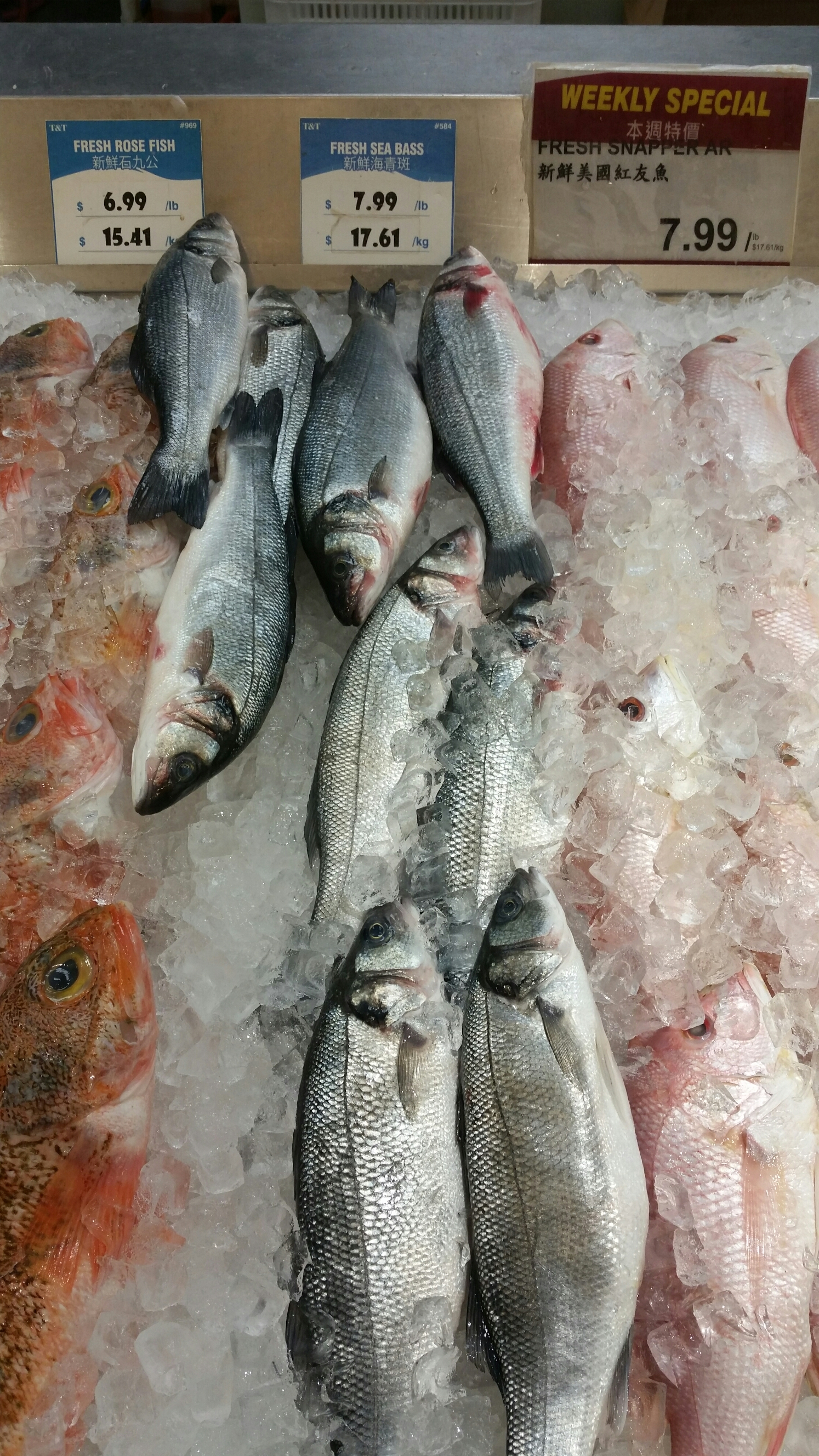 Whole roasted sea bass design with rev for Closest fish market